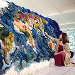 Heathrow unveils massive tapestry at T2