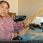 Mary Weahkee makes a turkey feather blanket